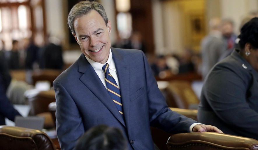 """FILE - In this April 19, 2017, file photo, Texas Speaker of the House Joe Straus, R-San Antonio, talks with fellow lawmakers on the House floor at the Texas Capitol in Austin. Straus has for months opposed a """"bathroom bill"""" targeting transgender people, saying the proposal could spark boycotts that could hurt the state's economy. The Legislature is heading into special session on Tuesday, July 25 and conservative groups have promised to target Straus and his key House lieutenants during March's GOP primaries if the issue doesn't pass. (AP Photo/Eric Gay, File)"""