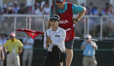 South Korea's Sung Hyun Park lines up a putt on the 17th green during the final round of the U.S. Women's Open Golf tournament Sunday, July 16, 2017, in Bedminster, N.J. (AP Photo/Julie Jacobson)