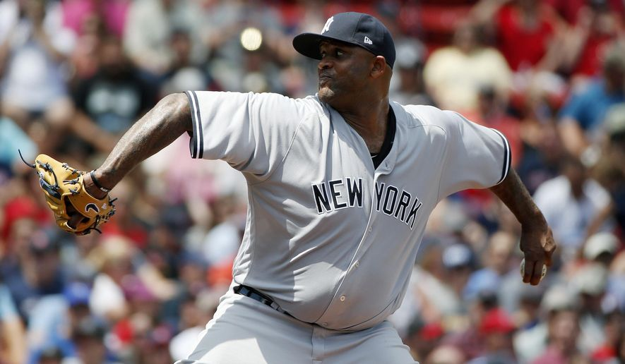 New York Yankees' CC Sabathia pitches during the first inning of the first game of a baseball doubleheader against the Boston Red Sox in Boston, Sunday, July 16, 2017. (AP Photo/Michael Dwyer)