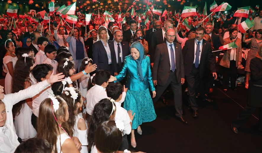 A cheering crowd of tens of thousands welcomed National Council of Resistance of Iran President-elect Maryam Rajavi to the July 1 Free Iran Rally. (Photo:TME)
