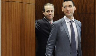 In this April 29, 2016, file photo, David Robert Daleiden, right, with attorney Jared Woodfill leave a courtroom after a hearing in Houston. A federal judge found the anti-abortion activist, known for clandestine videos of abortion-rights advocates, in contempt on Monday, July 17, 2017, after additional secretly-taken recordings appeared online. In a separate legal matter, the 9th U.S. Circuit Court of Appeals on May 16, 2018 dealt a blow to Mr. Daleiden by refusing to toss out a Planned Parenthood lawsuit against the activist's organization, the Center for Medical Progress. (AP Photo/Pat Sullivan, File) **FILE**