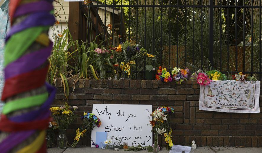 A memorial to an Australian woman who was shot and killed late Saturday by police, is seen Sunday evening, July 16, 2017 in Minneapolis. The Bureau of Criminal Apprehension released a statement Sunday saying two Minneapolis officers responded to a 911 call for a potential assault late Saturday. Exact details weren't released, but officials said an officer fired a gun, killing the woman. (Jeff Wheeler/Star Tribune via AP)