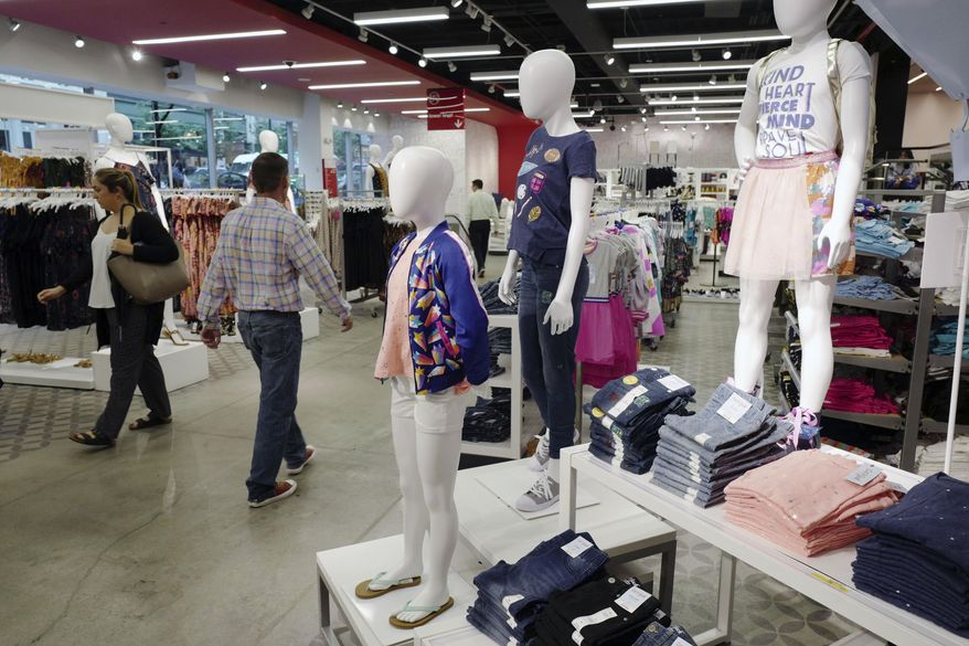 This Friday, July 14, 2017, photo shows Cat & Jack jeans and tops, made with Repreve polyester fabric created from recycled plastic bottles, on display at a Target store in New York. A growing number of major retailers such as fast-fashion chain H&M, Target Corp. and J.C. Penney are coming out with fashions that use waste from all types of trash, including plastic bottles. But price still rules for shoppers. (AP Photo/Mark Lennihan) ** FILE **