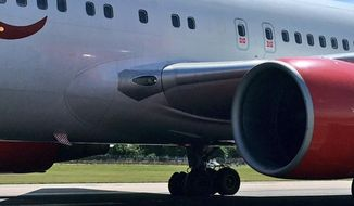 In this photo taken from the twitter feed of passenger Mike Gibson, a view of the blown tire of an Air Canada plane which abandoned flight, at London Gatwick , Monday, July 17, 2017. A flight from London to Toronto carrying 282 passengers has been forced to turn back after one of its tires burst as it took off.  (Mike Gibson via AP)