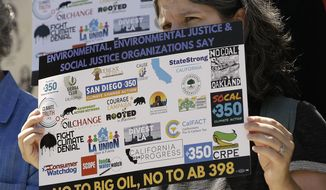 Catherine Garoupa joins others critical of Gov. Jerry Brown's cap-and-trade program, calling for defeat of the bill at a news conference, Monday, July 17, 2017, in Sacramento, Calif. California lawmakers are expected to vote Monday on AB398, Monday, which critics say is too friendly to the oil industry. (AP Photo/Rich Pedroncelli)