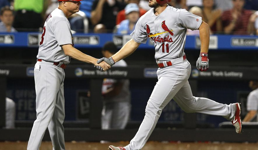 St. Louis Cardinals third base coach Mike Shildt, left, congratulates Paul DeJong, who rounds the bases after hitting a two-run home run during the sixth inning of the team's baseball game against the New York Mets, Monday, July 17, 2017, in New York. (AP Photo/Kathy Willens)
