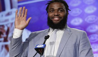 FILE - In this July 13, 2017, file photo, Clemson's Christian Wilkins waves to the media during the Atlantic Coast Conference NCAA college football media day, in Charlotte, N.C. It's Wilkins time to be the face of Clemson _ a role the 6-foot-4, 310-pound junior is more than ready to to take on. (AP Photo/Chuck Burton, File)