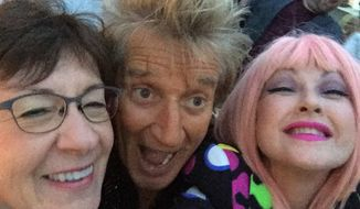 Cyndi Lauper pulled Sen. Susan Collins onstage during a concert with Rod Stewart Friday night, praising the Maine Republican for her work addressing youth homelessness. (Cyndi Lauper)