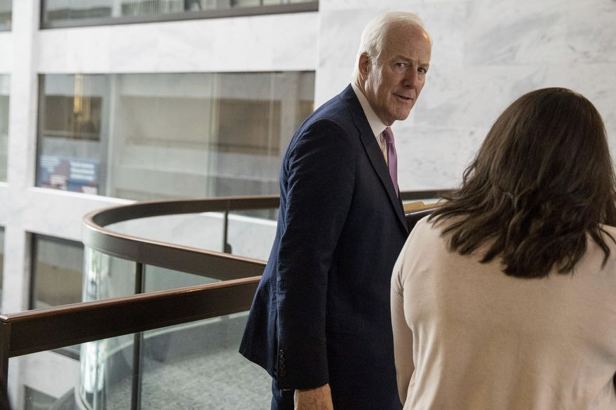 Senate Majority Whip John Cornyn of Texas makes his way to the Capitol Building on Capitol Hill in Washington, Monday, July 17, 2017. The Senate has been forced to put the Republican's health care bill on hold for as much as two weeks until Sen. John McCain, R-Ariz., can return from surgery. (AP Photo/Andrew Harnik)