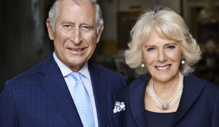 CORRECTS NAME  This photo taken in May 2017 shows Britain's Prince Charles and his wife Camilla, Duchess of Cornwall in Clarence House, London. The photograph has been released by Clarence House to mark the Duchess of Cornwall's 70th birthday. (Mario Testino via Clarence House via AP)