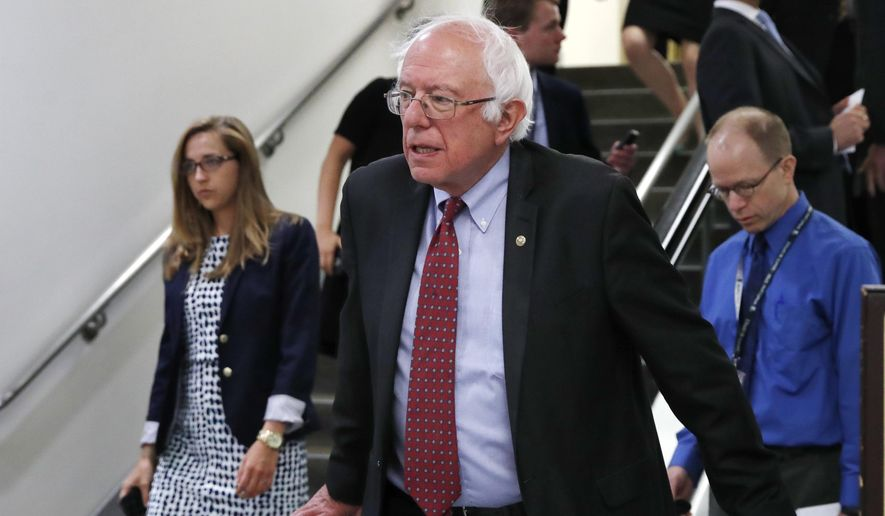 FILE - In this July 11, 2017, file photo, Sen. Bernie Sanders, I-Vt. rides an escalator on Capitol Hill in Washington. Republicans are fending off questions about Russia and the Trump campaign, and dealing with an unpopular health care plan. But Democrats have yet to unify behind a clear, core message that will help them take advantage of their opponents' struggles. (AP Photo/Jacquelyn Martin, File)