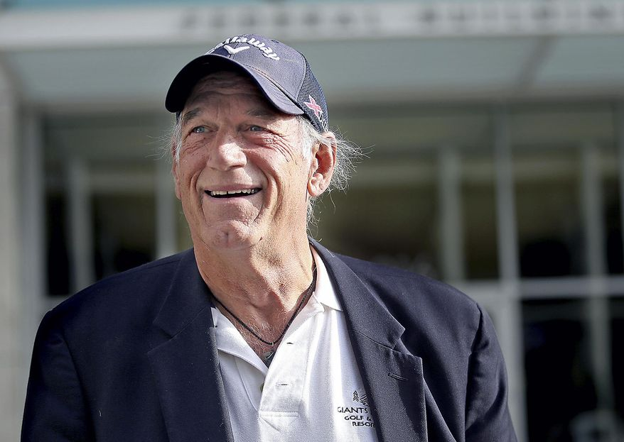 """FILE - In this Oct. 20, 2015, file photo, former Minnesota Gov. Jesse Ventura talks to reporters outside the federal building in St. Paul, Minn. Ventura says he never said the motto, """"Win if you can, lose if you must, but always cheat,"""" that's featured on a new biographical plaque that went up this month next to his portrait at the state Capitol. (Elizabeth Flores /Star Tribune via AP, File)"""
