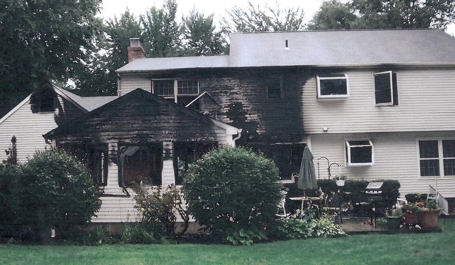 FILE - This July 2007 file photo provided by police, made available Sept. 21, 2011, by the Connecticut Judicial Branch as evidence and presented in the Joshua Komisarjevsky trial in New Haven, Conn., shows a fire-damaged portion of the William Petit home in Cheshire, Conn., where his wife Jennifer Hawke-Petit and daughters Hayley and Michaela were killed during a home invasion July 23, 2007. (AP Photo/Connecticut Judicial Branch, File)