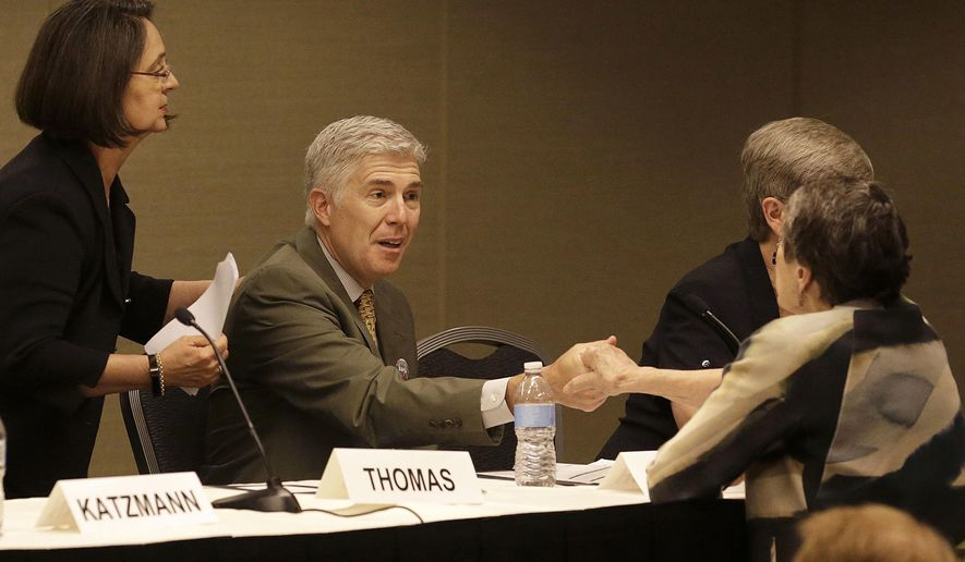 Associate Supreme Court Justice Neil Gorsuch, center, shakes hands with an attendee after speaking during a civics program showcase at the 2017 Ninth Circuit Judicial Conference in San Francisco, Monday, July 17, 2017. (AP Photo/Jeff Chiu, Pool)