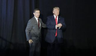 FILE - In this Sept. 29, 2016, file photo, retired Gen. Michael Flynn, left, introduces then-Republican presidential candidate Donald Trump at a campaign rally, in Bedford, N.H. Flynn, the former National Security Adviser at the center of multiple probes into Russia's interference in the 2016 presidential election, is seeking sanctuary from the swirling eddy of news coverage in Middletown, R.I., the beach town where he grew up. (AP Photo/John Locher, File)