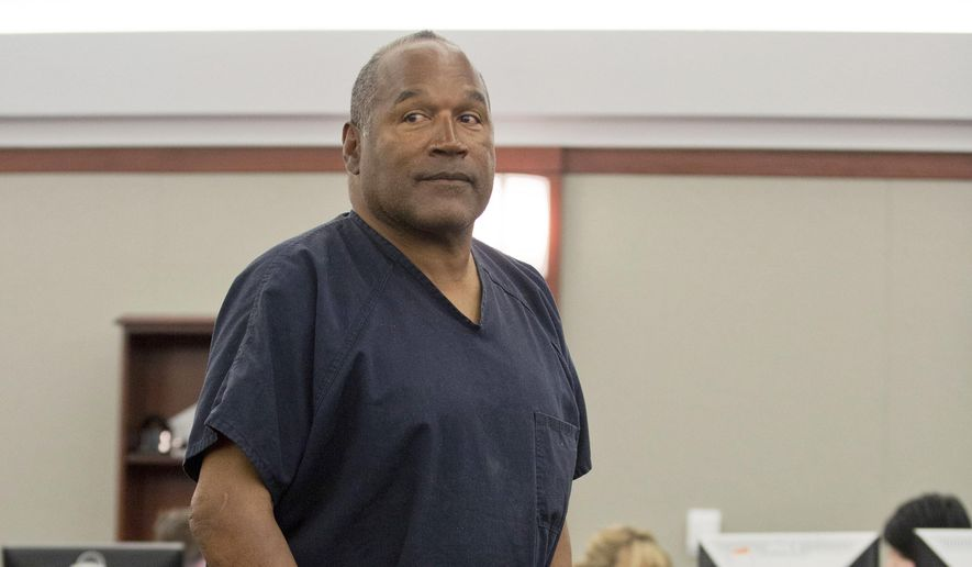 In this May 15, 2013 file photo, O.J. Simpson returns to the witness stand to testify after a break during an evidentiary hearing in Clark County District Court in Las Vegas. Simpson, the former football star, TV pitchman and now Nevada prison inmate, will have a lot going for him when he appears before state parole board members Thursday, July 20, 2017, seeking his release after more than eight years for an ill-fated bid to retrieve sports memorabilia. (AP Photo/Julie Jacobson, Pool, file)