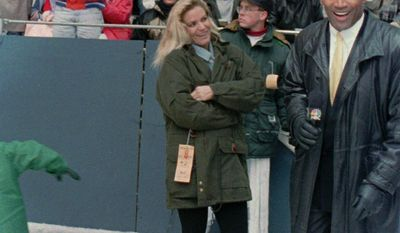 FILE - In this Nov 25, 1993 file photo, O.J. Simpson stands with his wife Nicole Brown Simpson while broadcasting on the sidelines during the Thanksgiving Day NFL football game between the Dallas Cowboys and the Miami Dolphins at Texas Stadium in Irving, Texas. Simpson retired from football after the 1979 season, later being inducted into the Pro Football Hall of Fame and beginning careers in acting and football broadcasting. Simpson's ex-wife, Nicole Brown Simpson, and her friend Ronald Goldman are found dead in Los Angeles in June 1994. (AP Photo/Ron Heflin, File)