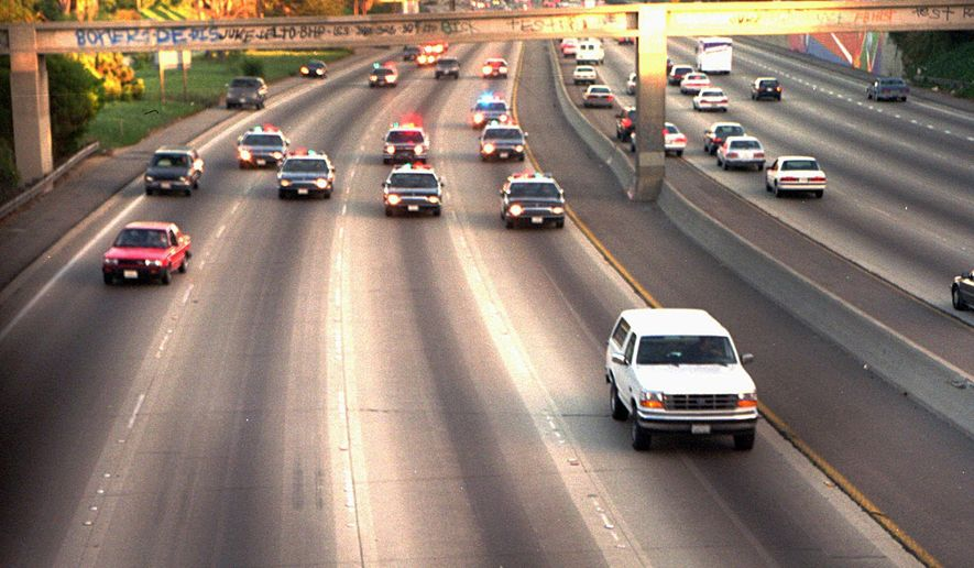 In this June 17, 1994, file photo, a white Ford Bronco, driven by Al Cowlings carrying O.J. Simpson, is trailed by Los Angeles police cars as it travels on a freeway in Los Angeles. Simpson's ex-wife, Nicole Brown Simpson, and her friend Ronald Goldman are found dead in Los Angeles. Simpson is later arrested after a widely televised freeway chase in his white Ford Bronco. (AP Photo/Joseph Villarin, File)