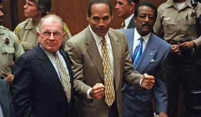 FILE - In this Oct. 3, 1995 file photo, O.J. Simpson, center, reacts as he is found not guilty of murdering his ex-wife Nicole Brown Simpson and her friend Ron Goldman, with attorneys F. Lee Bailey, left, and Johnnie Cochran Jr., right, in Los Angeles Superior Court. Simpson, the former football star, TV pitchman and now Nevada prison inmate, will have a lot going for him when he appears before state parole board members Thursday, July 20, 2017 to release him after more than eight years for an ill-fated bid to retrieve sports memorabilia. (Myung J. Chun/Daily News via AP, Pool, File)