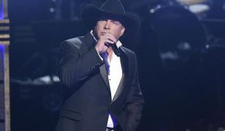 FILE - In this Nov. 2, 2016 file photo, Garth Brooks performs at the 50th annual CMA Awards in Nashville, Tenn. Brooks offered to pay for a Hawaiian honeymoon for a couple that got engaged at his Oklahoma City concert on July 15, 2017. (Photo by Charles Sykes/Invision/AP, File)