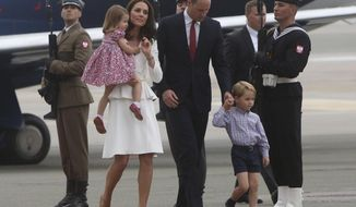 From foreground left, Britain's Kate, the Duchess of Cambridge holding Princess Charlotte, Prince William and Prince George walk past honor guards, during the arrival ceremony, at the airport, in Warsaw , Poland, Monday, July 17, 2017. The Duke and Duchess of Cambridge and their children have arrived in Poland, the first leg of a goodwill trip to two European Union nations that seeks to underscore Britain's friendly ties despite its negotiations to leave the bloc. (AP Photo/Czarek Sokolowski)