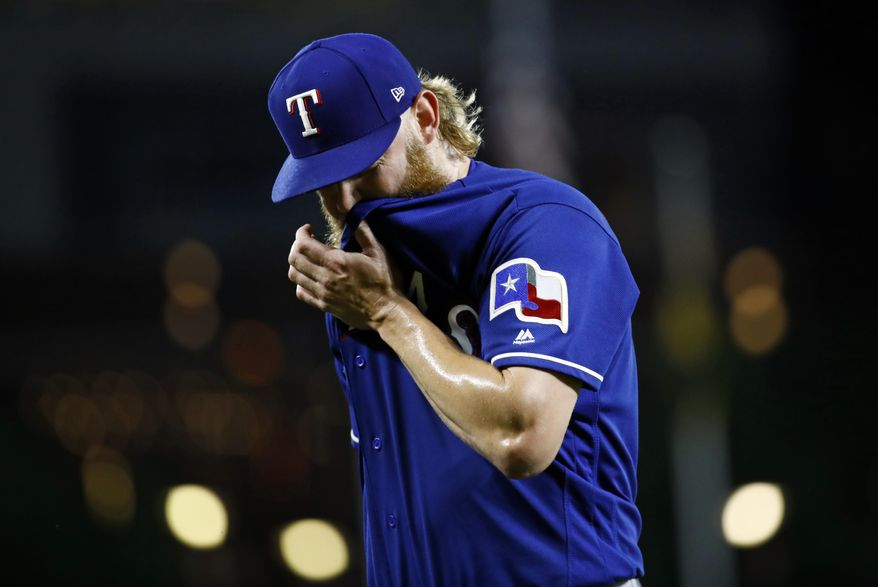 Texas Rangers starting pitcher Andrew Cashner walks off the field after being removed during the seventh inning of the team's baseball game against the Baltimore Orioles in Baltimore, Monday, July 17, 2017. Baltimore won 3-1. (AP Photo/Patrick Semansky)