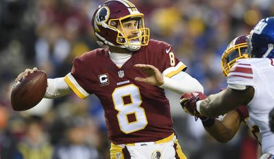 FILE - In this Jan. 1, 2017, file photo, Washington Redskins quarterback Kirk Cousins (8) passes during the first half of an NFL football game against the New York Giants, in Landover, Md. Cousins is expected to play a second consecutive season on the franchise tag unless his camp and the Washington Redskins surprisingly reach a last-minute agreement on a long-term contract. (AP Photo/Nick Wass, File)