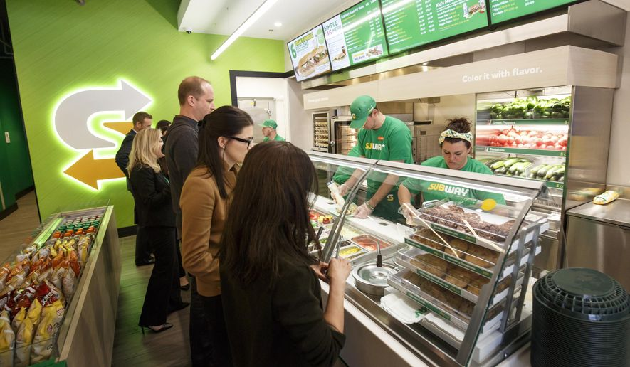 This January 2017 photo provided by Subway shows the interior of a remodeled Subway store in Knoxville, Tenn. Subway is looking to update the look of its stores as the chain's U.S. sales have been declining. The company says the redesign, which includes a brighter atmosphere, displays of vegetables behind the counter and ordering tablets, is the first major revamp since the early 2000s. (Chris Radcliffe/Subway via AP)