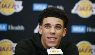 FILE - In this June 23, 2017, file photo, Los Angeles Lakers draft pick Lonzo Ball speaks during a news conference in El Segundo, Calif. In the midst of the worst stretch in franchise history, the Lakers may have finally found the cornerstone of their future.  (AP Photo/Jae C. Hong, File)