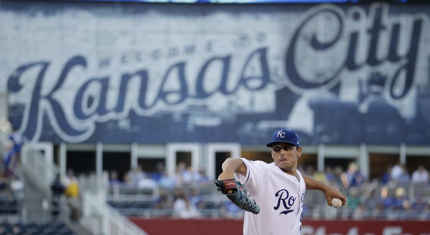 Kansas City Royals starting pitcher Jason Vargas throws during the first inning of the team's baseball game against the Detroit Tigers on Monday, July 17, 2017, in Kansas City, Mo. (AP Photo/Charlie Riedel)