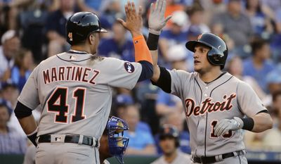 Detroit Tigers' Mikie Mahtook, right, celebrates with Victor Martinez (41) after hitting a two-run home run during the third inning of the team's baseball game against the Kansas City Royals on Monday, July 17, 2017, in Kansas City, Mo. (AP Photo/Charlie Riedel)