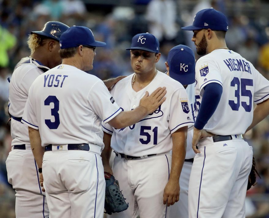 Kansas City Royals starting pitcher Jason Vargas (51) is removed during the third inning of the team's baseball game against the Detroit Tigers on Monday, July 17, 2017, in Kansas City, Mo. (AP Photo/Charlie Riedel)