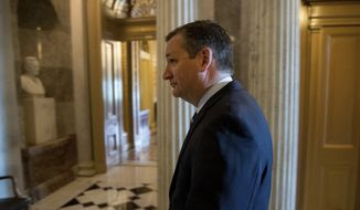 Sen. Ted Cruz, R-Texas arrives on Capitol Hill in Washington, Tuesday, July 18, 2017. (AP Photo/Andrew Harnik)