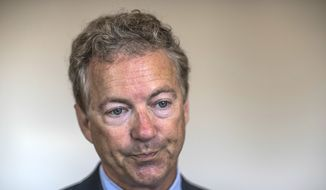Sen. Rand Paul pauses as he speaks to members of the media on Monday, July 17, 2017, at Lawton Insurance in Bowling Green, Ky. (Austin Anthony/Daily News via AP)