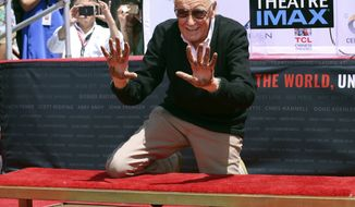 Stan Lee raises his hands after placing them in cement at his hand and footprint ceremony at the TCL Chinese Theatre on Tuesday, July 18, 2017, in Los Angeles. (Photo by Willy Sanjuan/Invision/AP)