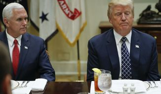 President Donald Trump, accompanied by Vice President Mike Pence, pauses after speaking to members of the media during a lunch with services members in the Roosevelt Room of the White House in Washington, Tuesday, July 18, 2017. (AP Photo/Pablo Martinez Monsivais)