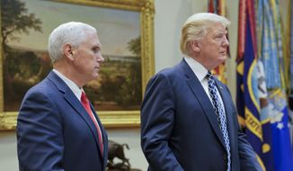 President Donald Trump, with Vice President Mike Pence, prepares to sit down to have lunch with services members in the Roosevelt Room of the White House in Washington, Tuesday, July 18, 2017. (AP Photo/Pablo Martinez Monsivais)