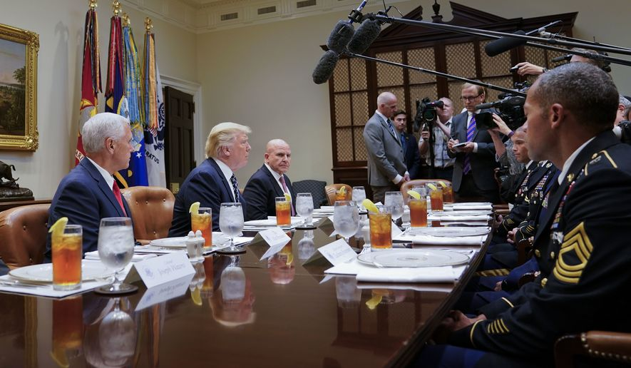 President Donald Trump, flanked by Vice President Mike Pence, left, and National Security Adviser H.R. McMaster, speaks while having lunch with services members in the Roosevelt Room of the White House in Washington, Tuesday, July 18, 2017. (AP Photo/Pablo Martinez Monsivais)