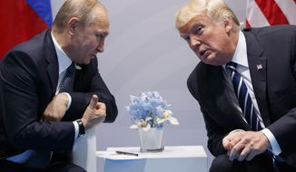 In this July 7, 2017, photo, President Donald Trump meets with Russian President Vladimir Putin at the G-20 Summit in Hamburg, Germany. Trump had a second, previously undisclosed conversation with Putin at the summit it Germany. White House spokesman Sean Spicer says that Trump and Putin spoke during a world leaders' dinner at the Group of 20 summit in Hamburg earlier this month. (AP Photo/Evan Vucci/File)