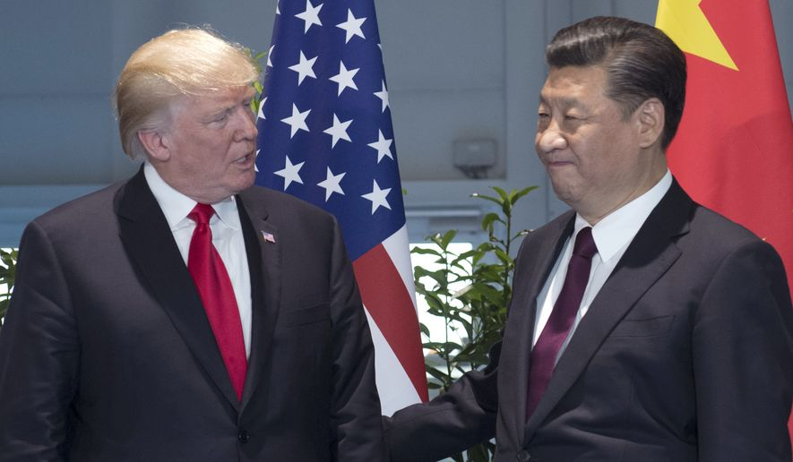 FILE - In this Saturday, July 8, 2017, file photo, U.S. President Donald Trump, left, and Chinese President Xi Jinping arrive for a meeting on the sidelines of the G-20 Summit in Hamburg, Germany. After a cordial meeting between Trump and Xi in April 2017, tensions are simmering again between the world's two biggest economies. As U.S. and Chinese economic officials prepare to meet Wednesday, July 19, in Washington, the U.S. is weighing whether to slap tariffs on steel imports and risk setting off a trade war, a dicey option to deal with a problem caused largely by China's massive overproduction of steel. (Saul Loeb/Pool Photo via AP, File)