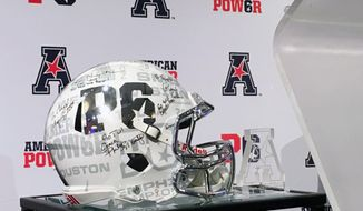 The P6 football helmet is displayed at American Athletic Conference media day in Newport, R.I., Tuesday, July 18, 2017 The conference is trying to brand itself as a peer to the most powerful leagues in college football in the hopes for creating a Power Six. To have any chance of doing so, the AAC will need new coaches to replicate the success of those who have left such as Tom Herman, Matt Rhule and Willie Taggart.  (AP Photo/Ralph D. Russo)