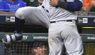 Seattle Mariners' Kyle Seager hugs Nelson Cruz after hitting the go-ahead home run off Houston Astros' relief pitcher Tony Sipp during the 10th inning of a baseball game, Monday, July 17, 2017, in Houston. (AP Photo/Eric Christian Smith)