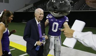 Kansas State head football coach Bill Snyder smiles beside team mascot Willie the Wildcat after speaking to reporters during the Big 12 NCAA college football media day in Frisco, Texas, Tuesday, July 18, 2017. (AP Photo/LM Otero)