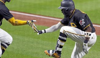 Pittsburgh Pirates' Josh Harrison, right, celebrates with Andrew McCutchen as he returns to the dugout after hitting a two-run home run off Milwaukee Brewers starting pitcher Junior Guerra during the sixth inning of a baseball game in Pittsburgh, Tuesday, July 18, 2017. (AP Photo/Gene J. Puskar)