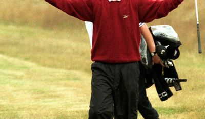 FILE - In this July 19, 1998, file photo, Britain's Justin Rose reacts after he chipped in on the 18th hole for eagle during the British Open golf championships at Royal Birkdale Golf Club in Southport, England. Rose was a slight 17-year-old golfer wearing a baggy red sweater and a wide smile when he produced one of the British Open's iconic moments in 1998, holing out from 45 yards for eagle at the 72nd hole to secure a tie for fourth place. (AP Photo/Roy Letkey, File)