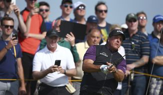Phil Mickelson of the United States watches his shot from 9th tee the during a practice round ahead of the British Open Golf Championship, at Royal Birkdale, Southport, England Tuesday, July 18, 2017. (AP Photo/Dave Thompson)