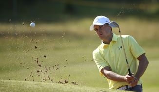 Jordan Spieth of the United States hits a shot out of a bunker on the 4th green during a practice round ahead of the British Open Golf Championship, at Royal Birkdale, Southport, England Tuesday, July 18, 2017. (AP Photo/Dave Thompson)