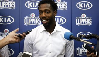 Los Angeles Clippers' Patrick Beverley talks to reporters after an NBA basketball news conference Tuesday, July 18, 2017, in Los Angeles. (AP Photo/Jae C. Hong)
