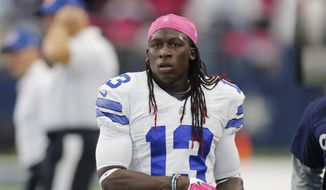 FILE - In this Oct. 11, 2015, file photo, Dallas Cowboys' Lucky Whitehead (13) prepares before an NFL football game against the New England Patriots in Arlington, Texas. Whitehead is asking for help locating his pitbull Blitz after burglars took the dog and demanded a $10,000 ransom. Whitehead told NBC 5 in Dallas that he was in Florida last week when Blitz was taken from his Texas home, along with some shoes and bags. (AP Photo/Brandon Wade, File)