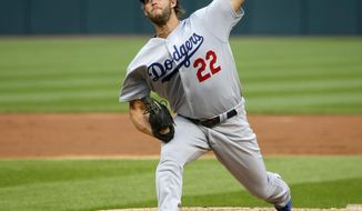 Los Angeles Dodgers starting pitcher Clayton Kershaw delivers during the first inning of the team's baseball game against the Chicago White Sox on Tuesday, July 18, 2017, in Chicago. (AP Photo/Charles Rex Arbogast)